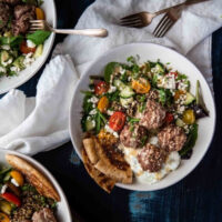 close up overhead photo of quinoa bowls with meatballs