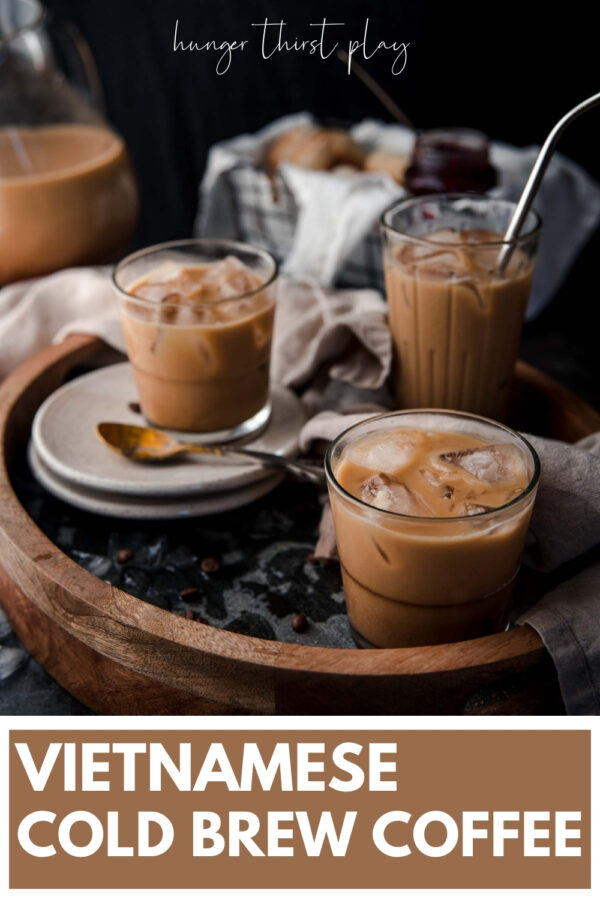 side angle of iced coffee in glasses with ice on a serving tray