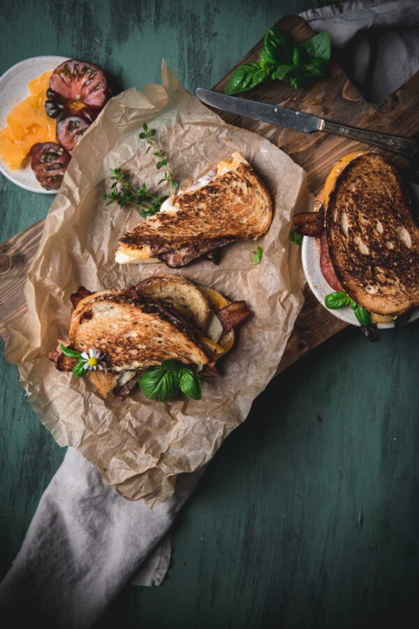 overhead image of cut triangles of bacon melt sandwich