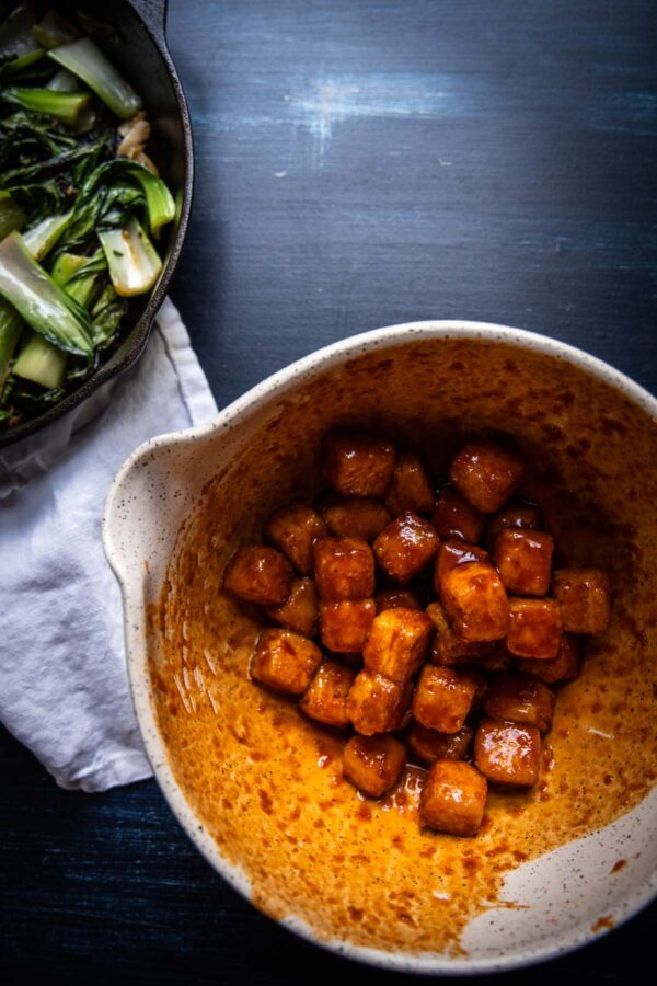 overhead of crisy tofu tossed with gochujang based sauce