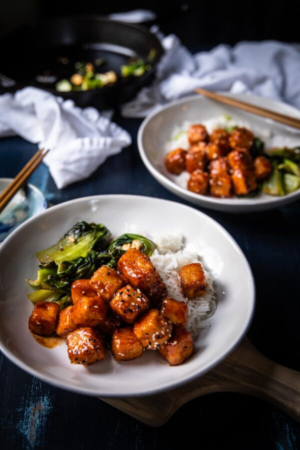 crispy tofu with sauteed bok choy and coconut rice on plates