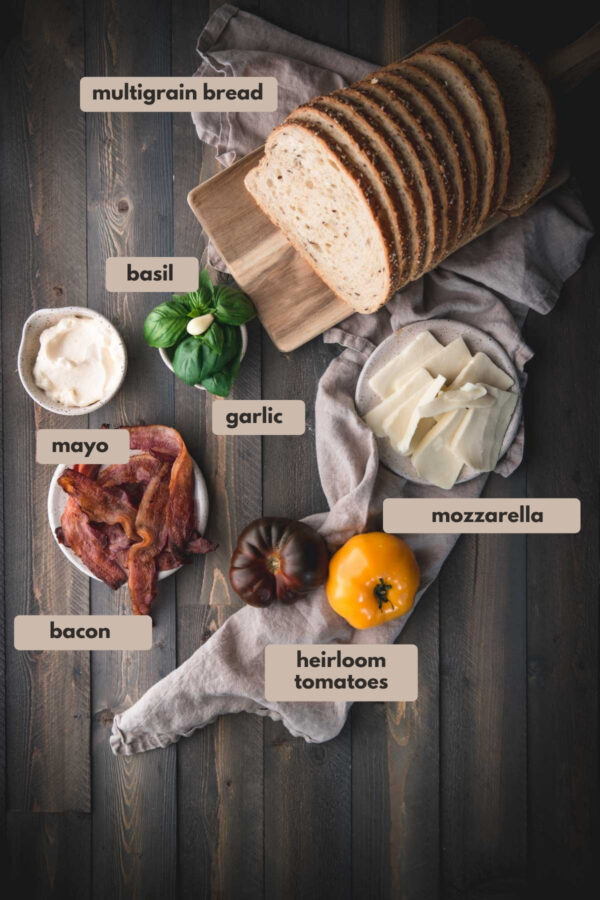 labeled ingredients for caprese and bacon sandwich