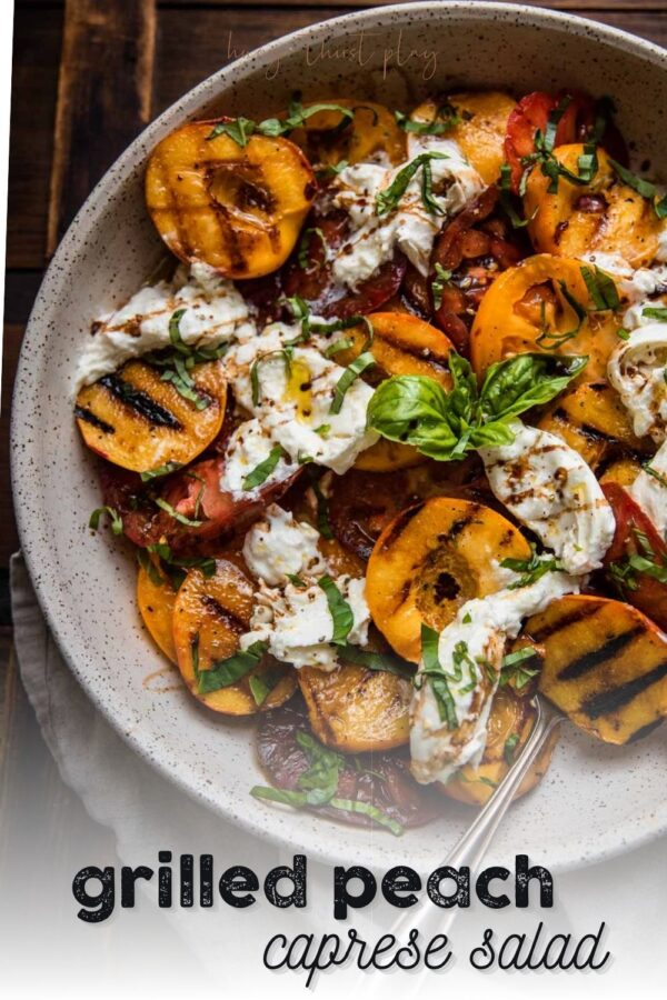 grilled peaches, sliced tomatoes and burrata in a platter bowl