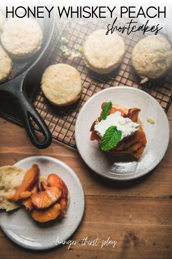 overhead of peaches spooned over biscuits with biscuits in a cast iron and on a cooling rack