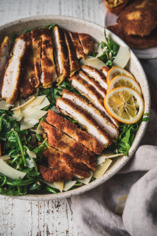 close up of sliced pieces of chicken milanese