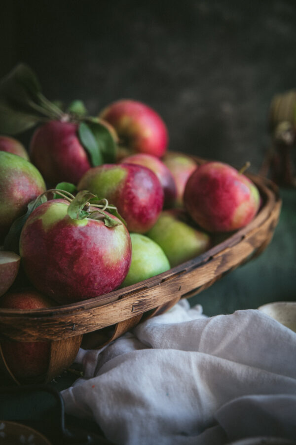 apples stacked in a basket