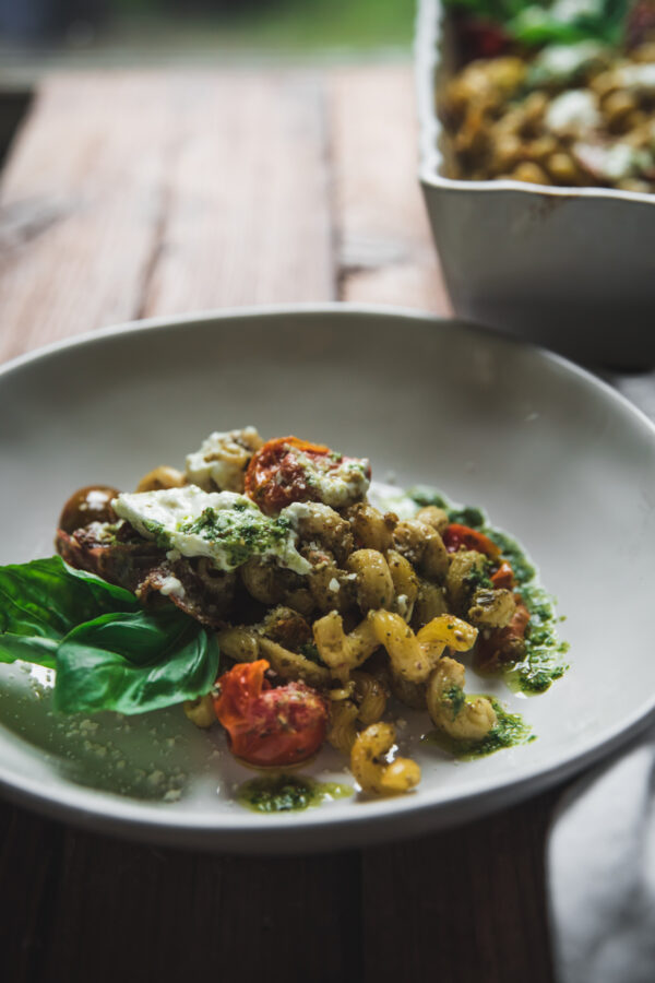 side angle of pesto pasta on a plate