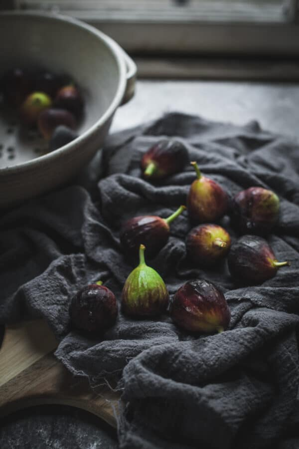 washed figs on a grey napkin