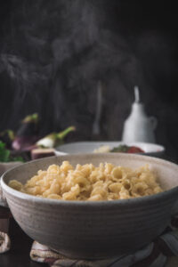 cooked pasta steaming in a bowl