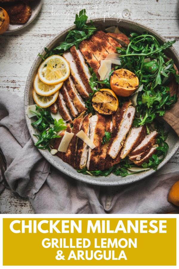 sliced crispy chicken over arugula with grilled lemon