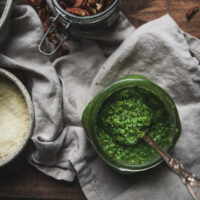 overhead photo of spoon scooping pesto out of jar