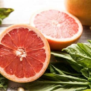 sliced grapefruit with large basil leaves