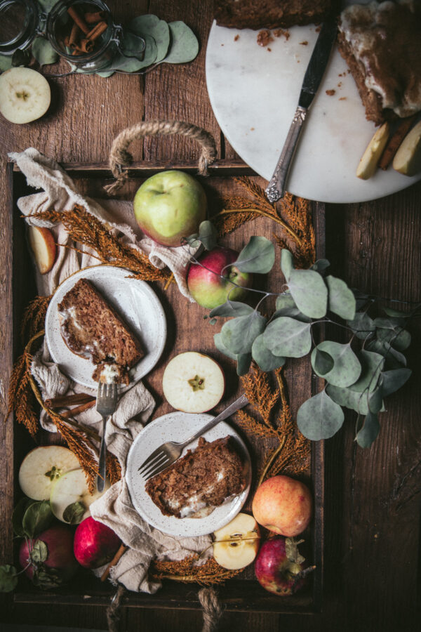overhead of slices of apple bread on a tray with whole apples
