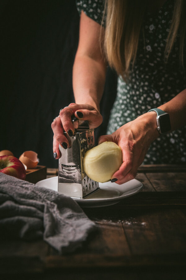 grating an apple onto a plate